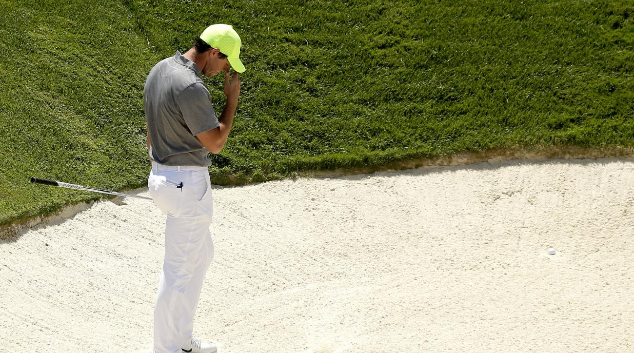 Rory McIlroy, of Northern Ireland, reacts after leaving his first bunker shot in the sand on the ninth hole during the rain delayed second round of the U.S. Open golf championship at Oakmont Country Club on Saturday, June 18, 2016, in Oakmont, Pa. (AP Pho
