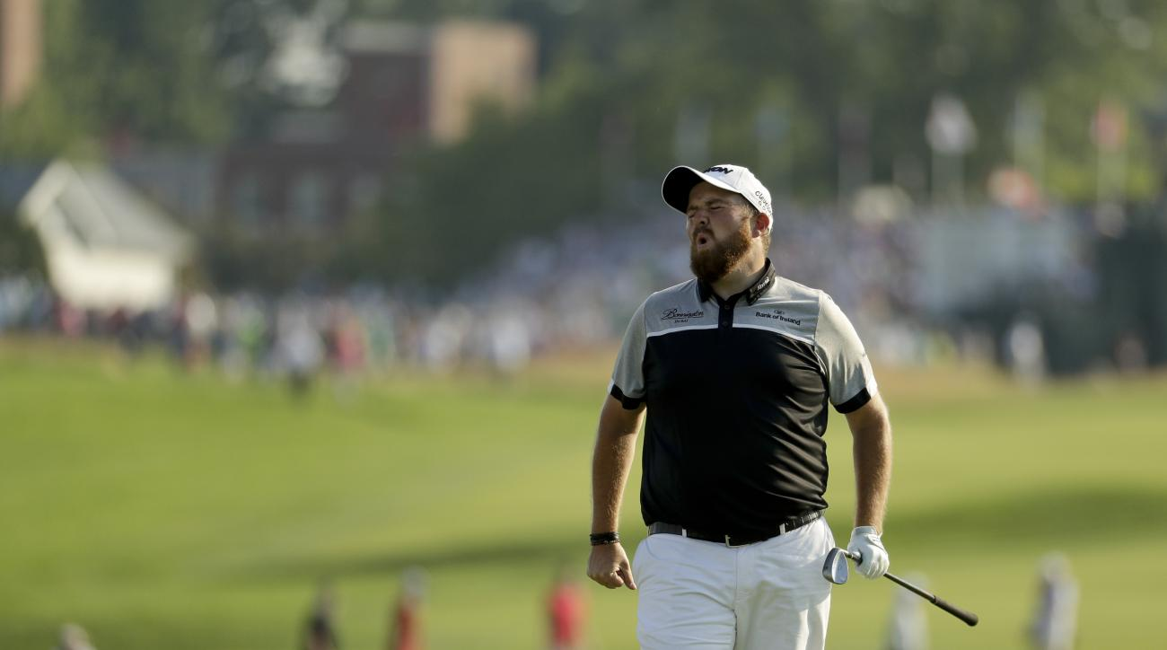Shane Lowry, of the Republic of Ireland, reacts after missing a shot on the 12th hole during the final round of the U.S. Open golf championship at Oakmont Country Club on Sunday, June 19, 2016, in Oakmont, Pa. (AP Photo/Charlie Riedel)
