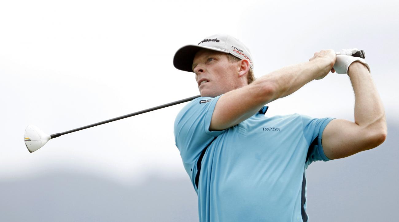 James Driscoll of the U.S. watches his drive from the 14th tee during the third round of the Puerto Rico Open PGA golf tournament in Rio Grande, Puerto Rico, Saturday, March 8, 2014. (AP Photo/Ricardo Arduengo)