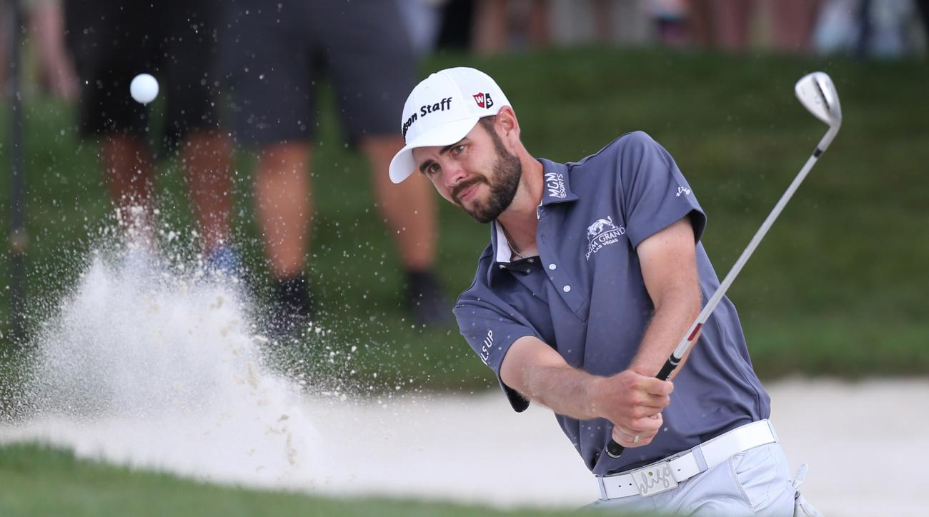 FILE - In this March 20, 2016 file photo, Troy Merritt hits the ball out of a bunker during the final round of the Arnold Palmer Invitational golf tournament in Orlando, Fla. Merritt is the defending champion at the Quicken Loans National, but that doesnt