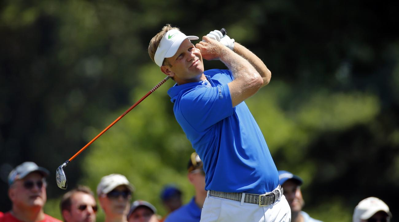 Billy Hurley III watches his shot from the second tee during the final round of the Quicken Loans National PGA golf tournament, Sunday, June 26, 2016, in Bethesda, Md. (AP Photo/Patrick Semansky)