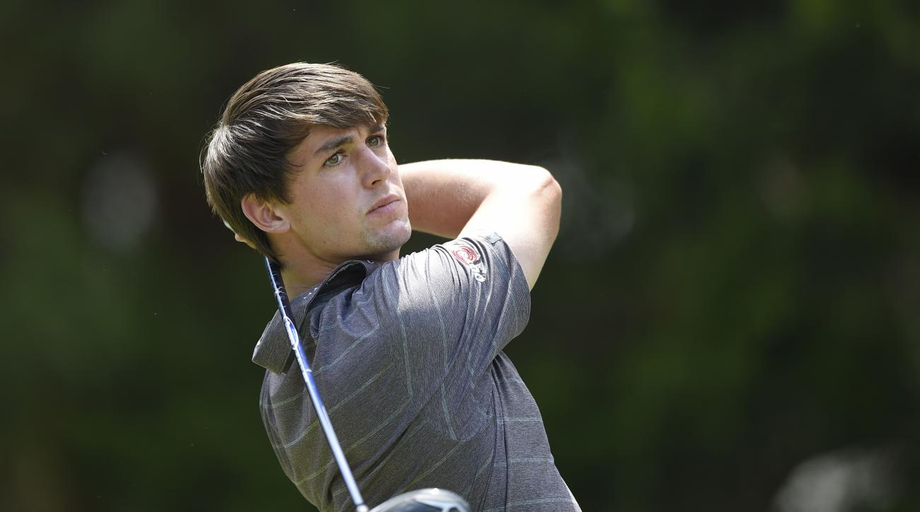 Ollie Schniederjans watches his tee shot on the second tee on the during the third round of the Quicken Loans National golf tournament at the Robert Trent Jones Golf Club in Gainesville, Va., Saturday, Aug. 1, 2015. (AP Photo/Nick Wass)