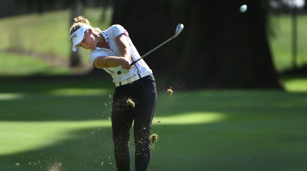 FILE- In this Aug. 15, 2015, file photo, Brooke Henderson, of Canada, hits her approach shot on the 18th hole during the third round of the LPGA Cambia Portland Classic golf tournament in Portland, Ore. Henderson has come a long way since her win last yea