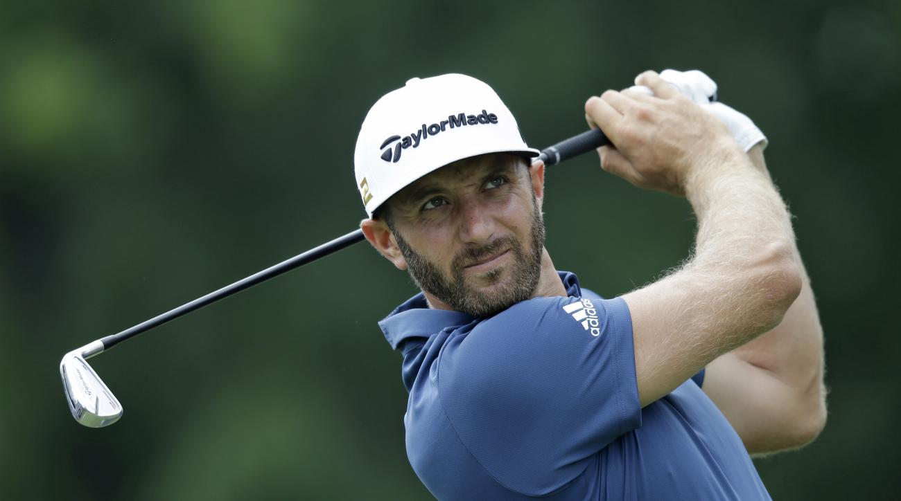 Dustin Johnson tees off on the third hole during the second round of the Bridgestone Invitational golf tournament at Firestone Country Club, Friday, July 1, 2016, in Akron, Ohio. (AP Photo/Tony Dejak)