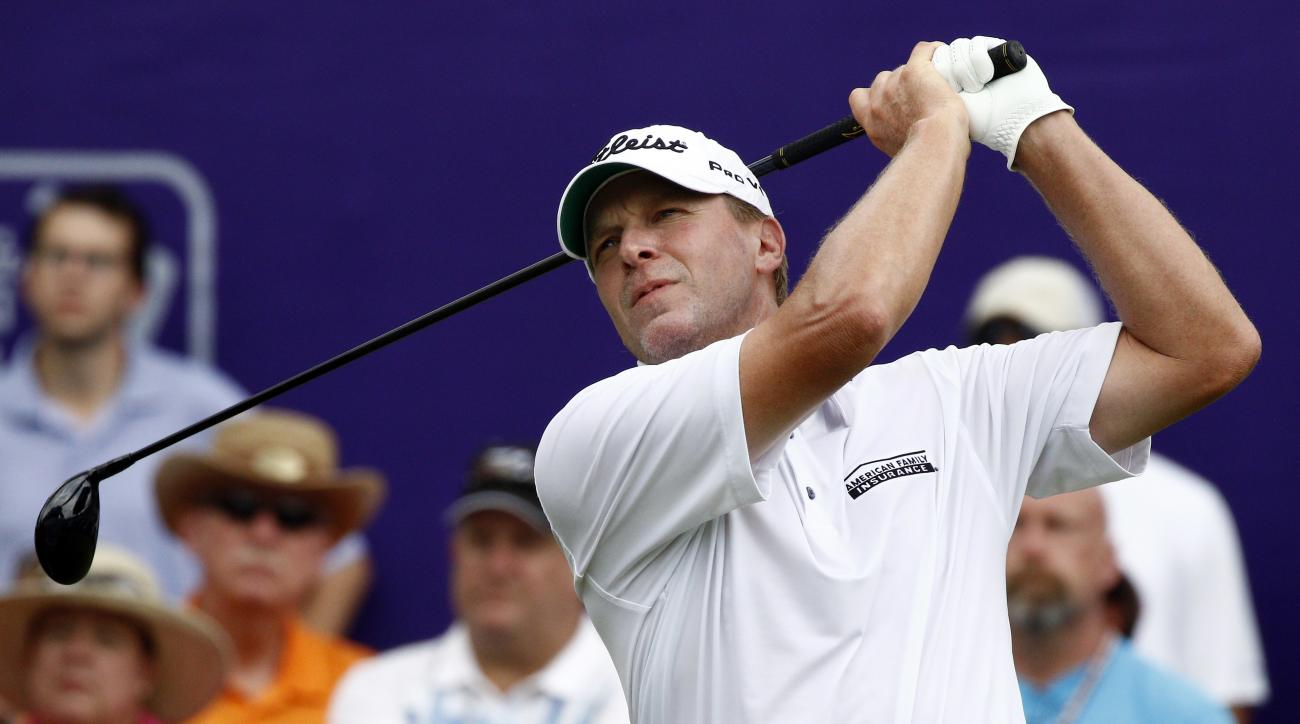 Steve Stricker hits off the No. 1 tee on the final round of the FedEx St. Jude Classic Golf Tournament, Sunday, June 12, 2016, in Memphis, Tenn. Play was suspended due to inclement weather. (AP Photo/Rogelio V. Solis)
