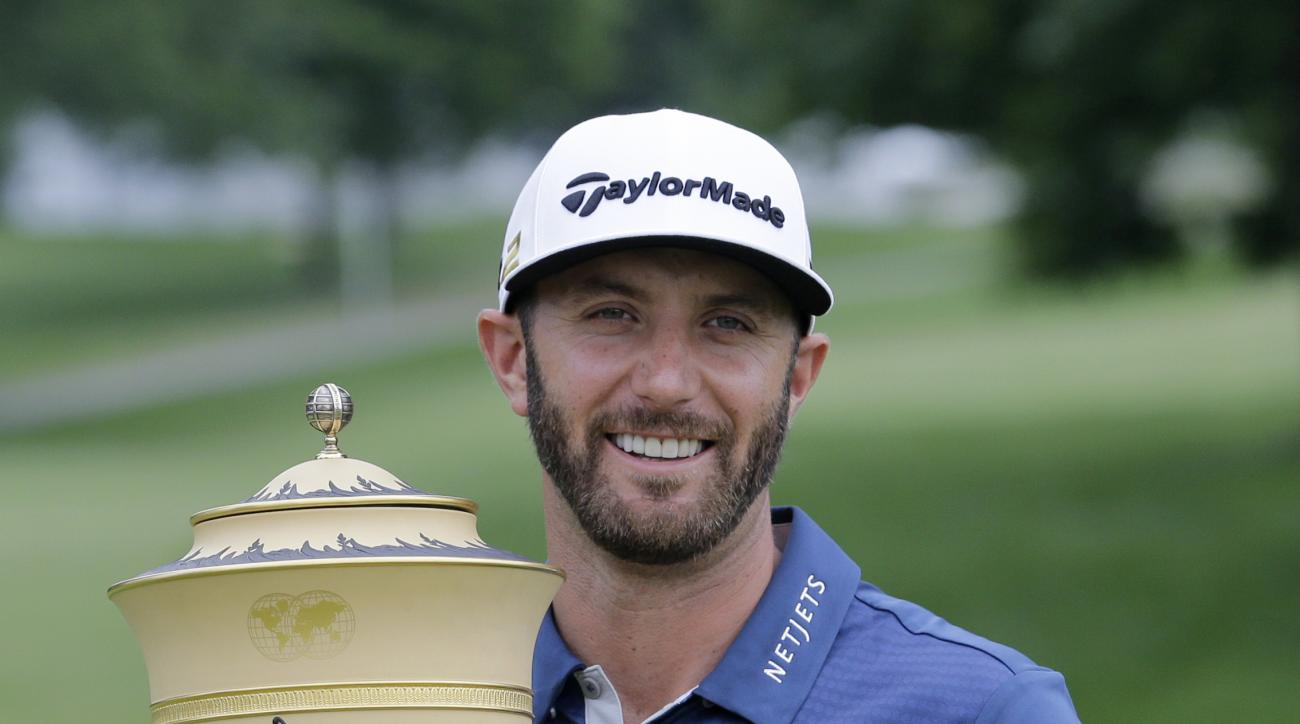 Dustin Johnson holds up the trophy after winning the Bridgestone Invitational golf tournament at Firestone Country Club, Sunday, July 3, 2016, in Akron, Ohio. (AP Photo/Tony Dejak)