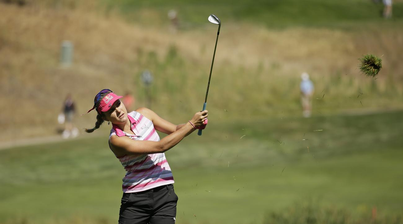 Lexi Thompson follows her shot from off the sixth fairway during the second round of the U.S. Women's Open golf tournament at CordeValle Friday, July 8, 2016, in San Martin, Calif. (AP Photo/Eric Risberg)