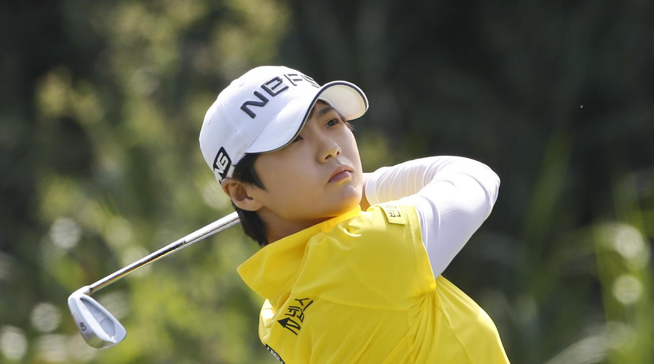 Sung Hyun Park, from South Korea, hits her tee shot pin the par three third hole during the final round of the Kia Classic women's golf tournament Sunday, March 27, 2016, in Carlsbad, Calif. (AP Photo/Lenny Ignelzi)