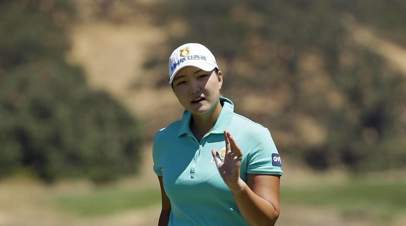 Mirim Lee, of South Korea, waves after making a birdie on the second green during the second round of the U.S. Women's Open golf tournament at CordeValle, Friday, July 8, 2016, in San Martin, Calif. (AP Photo/Eric Risberg)