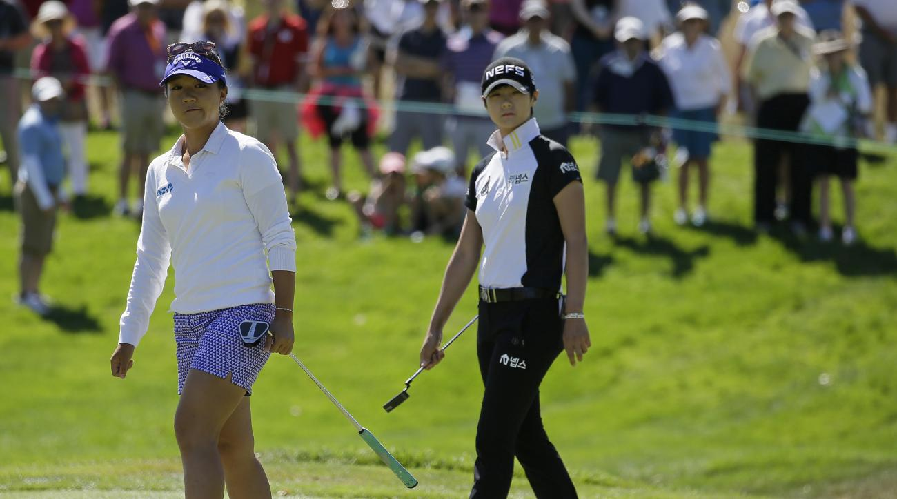 Lydia Ko, left, of New Zealand, reacts after missing a birdie putt on the first green as Sung Hyun Park, right, of South Korea, looks on during the final round of the U.S. Women's Open golf tournament at CordeValle, Sunday, July 10, 2016, in San Martin, C