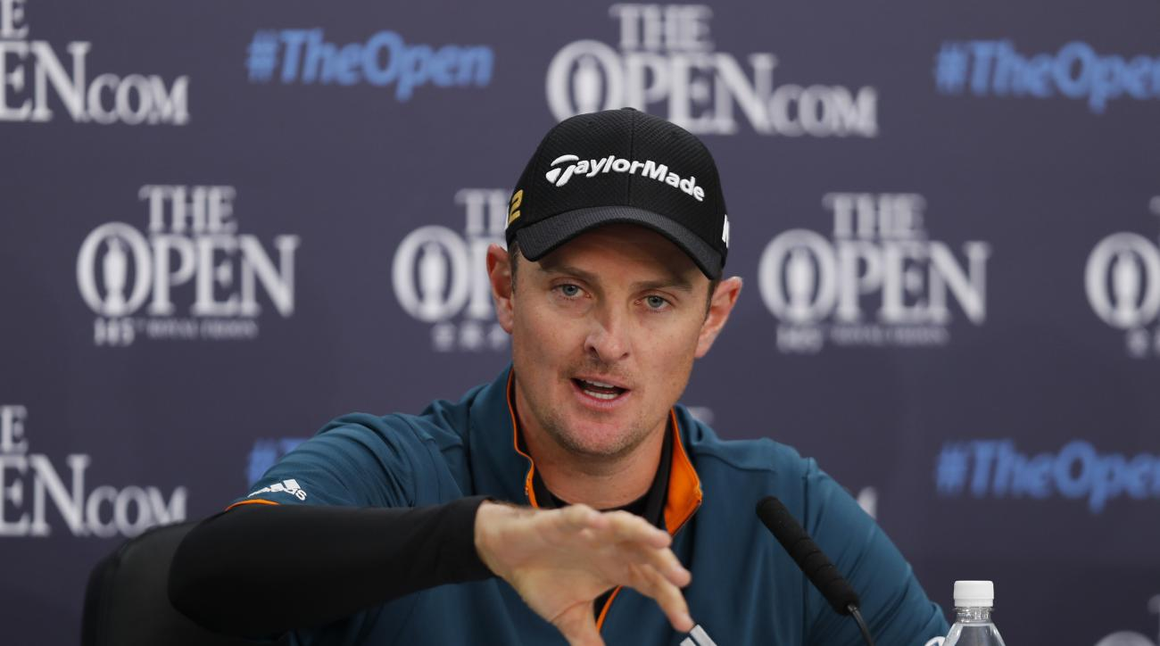 Britain's Justin Rose gestures as he speaks at a press conference ahead of the British Open Golf Championship at the Royal Troon Golf Club in Troon, Scotland, Tuesday July 12, 2016. (AP Photo/Ben Curtis)