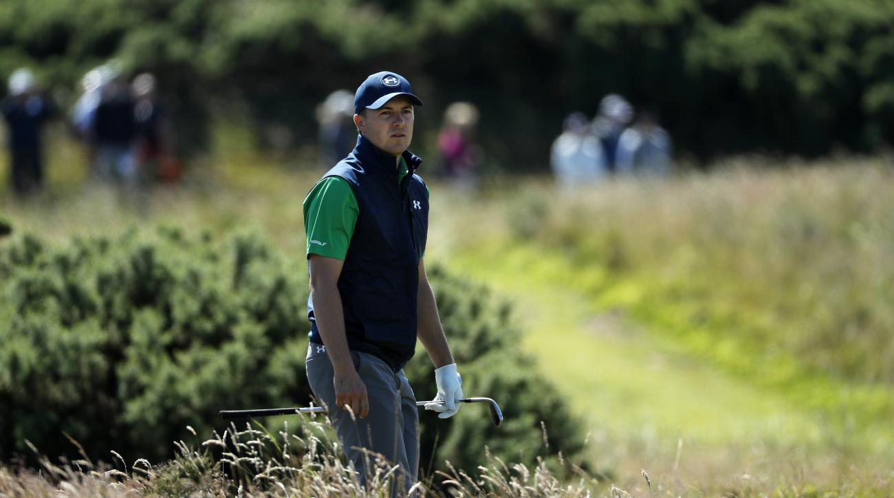 Jordan Spieth of the United States looks to see where his ball has landed after playing out of the rough on the edge of the 11th green during the first round of the British Open Golf Championship at the Royal Troon Golf Club in Troon, Scotland, Thursday,