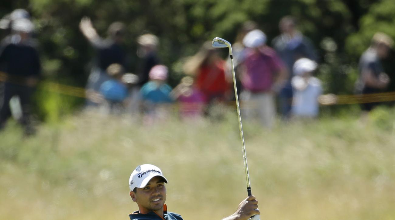 Jason Day of Australia plays a shot to the 11th green during the first round of the British Open Golf Championship at the Royal Troon Golf Club in Troon, Scotland, Thursday, July 14, 2016. (AP Photo/Matt Dunham)