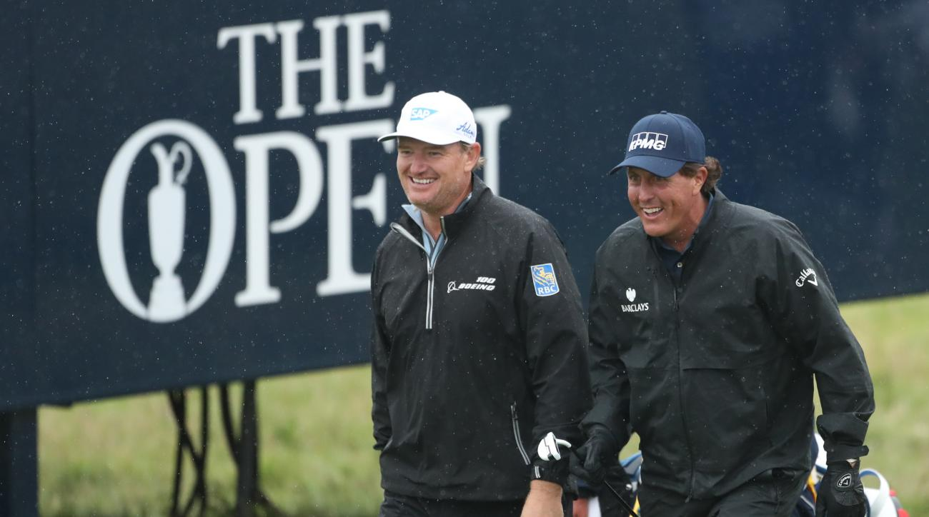 Phil Mickelson of the United States, right and playing partner Ernie Els walk to the 8th green during the second round of the British Open Golf Championship at the Royal Troon Golf Club in Troon, Scotland, Friday, July 15, 2016. (AP Photo/Peter Morrison)