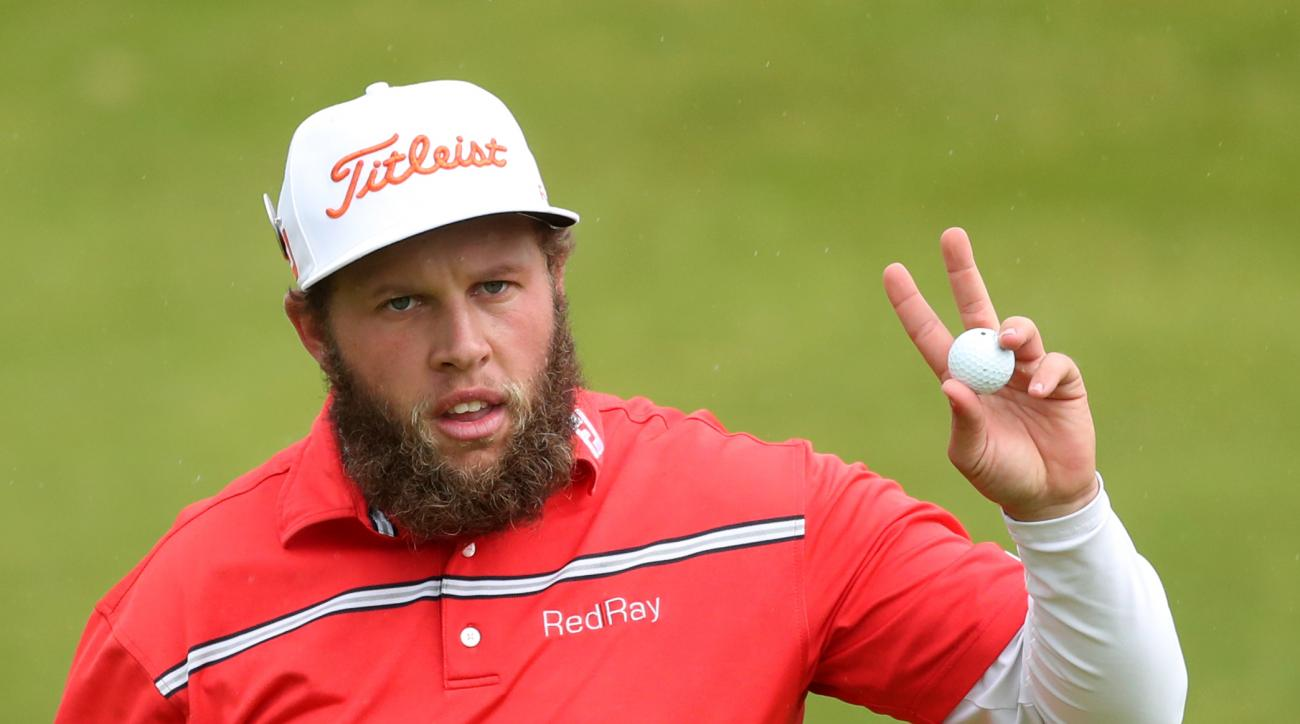 Andrew Johnston of England acknowledges the crowd after putting on the 15th green during the third round of the British Open Golf Championship at the Royal Troon Golf Club in Troon, Scotland, Saturday, July 16, 2016. (AP Photo/Peter Morrison)
