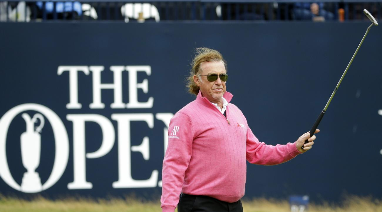 Miguel Angel Jimenez of Spain acknowledges the crowd after putting out to complete his final round on the 18th green during British Open Golf Championship at the Royal Troon Golf Club in Troon, Scotland, Sunday, July 17, 2016. (AP Photo/Matt Dunham)