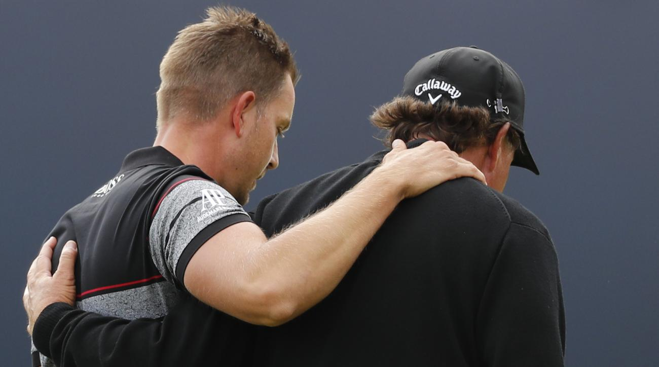 Henrik Stenson of Sweden, left and Phil Mickelson of the United States embrace as they walk off the 18th green after Stenson won the British Open Golf Championships at the Royal Troon Golf Club in Troon, Scotland, Sunday, July 17, 2016. (AP Photo/Ben Curt