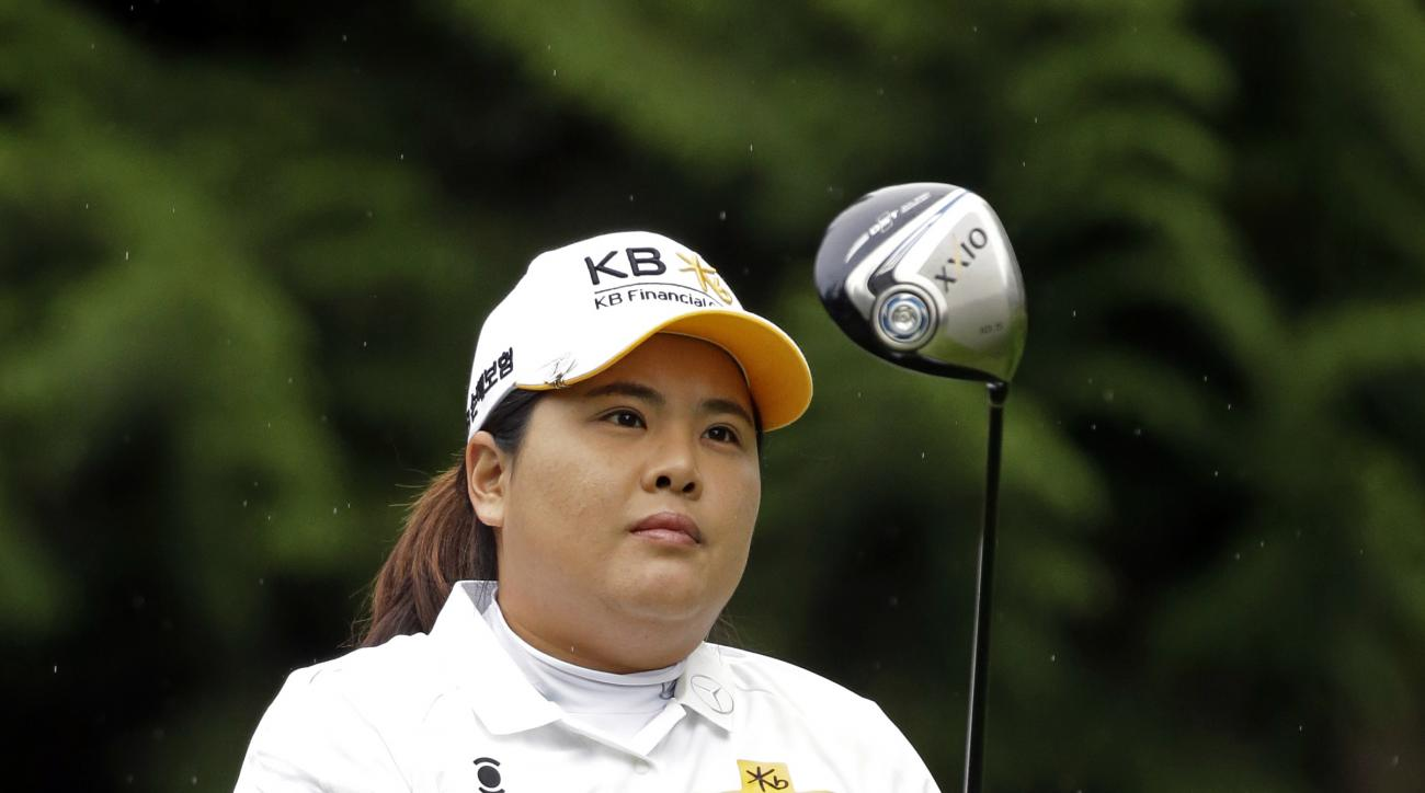 Inbee Park, of South Korea, in action in the first round at the Womens PGA Championship golf tournament at Sahalee Country Club Thursday, June 9, 2016, in Sammamish, Wash. (AP Photo/Elaine Thompson)