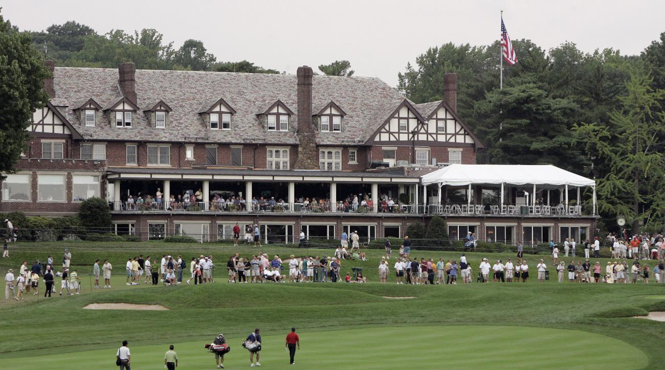 FILE - In this Aug. 9, 2005, file photo, Thomas Levet, of France, leads a group on the 18th fairway during practice for the PGA Championship at Baltusrol Golf Club in Springfield, N.J. Levet was practicing with Toru Taniguchi and Shigeki Maruyama, of Japa