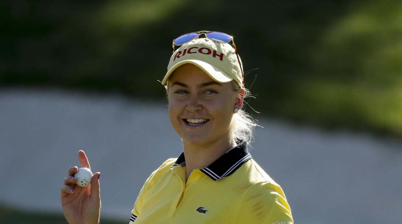 Charley Hull smiles on the 17th green during the third round of the LPGA Tour ANA Inspiration golf tournament at Mission Hills Country Club, Saturday, April 2, 2016, in Rancho Mirage, Calif. (AP Photo/Chris Carlson)