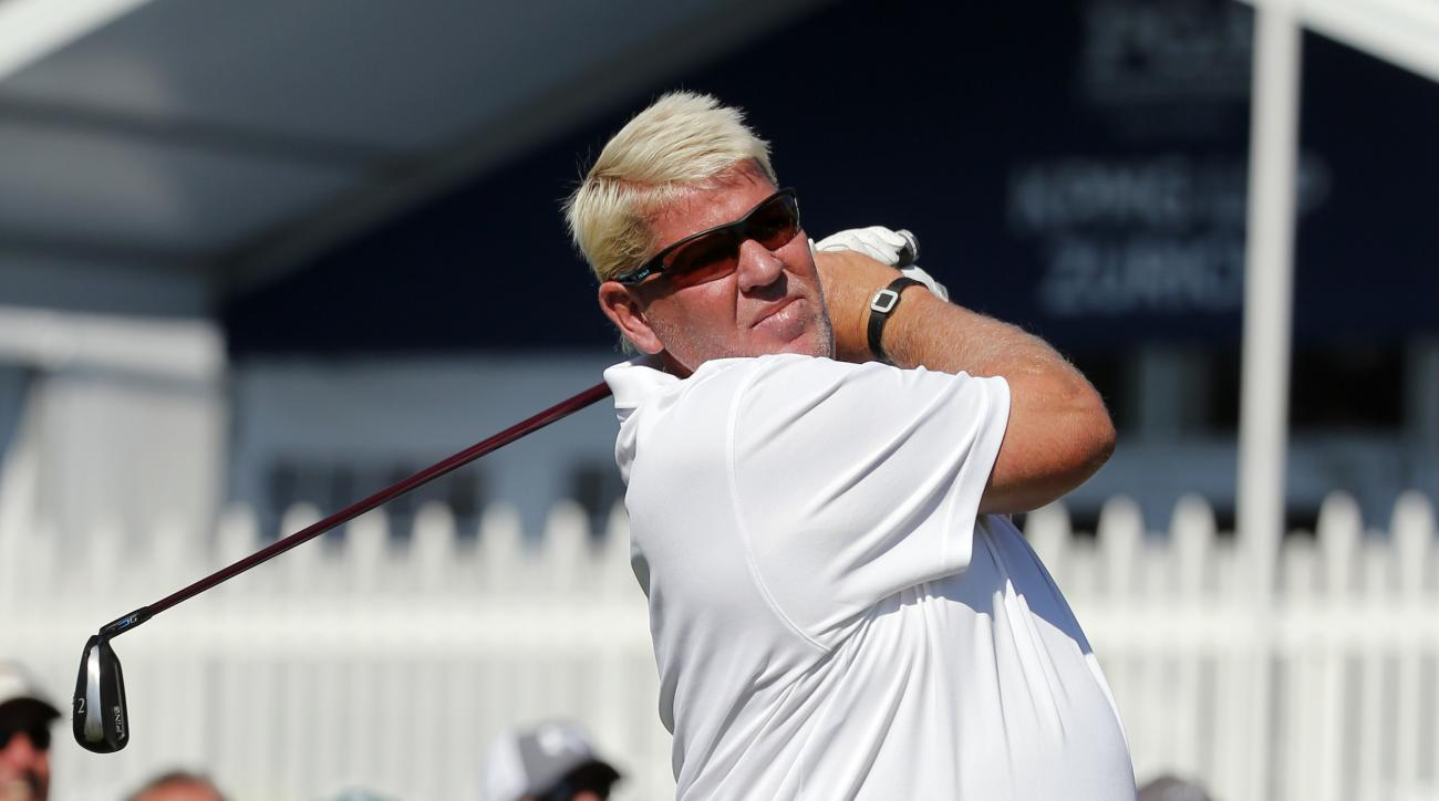 John Daly watches his tee shot on the 18th hole during a practice round for the PGA Championship golf tournament at Baltusrol Golf Club in Springfield, N.J., Wednesday, July 27, 2016. (AP Photo/Mike Groll)