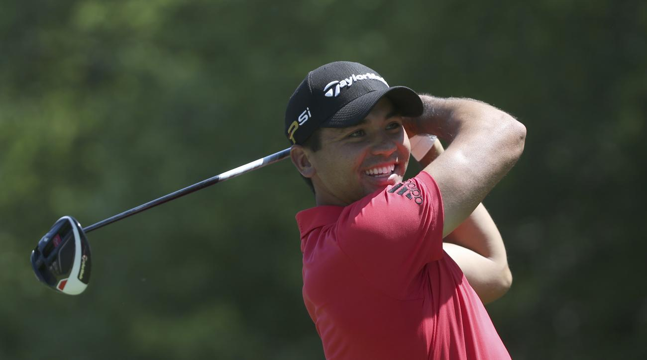 Jason Day smiles as he warms up on the sixth tee during a practice round for the PGA Championship golf tournament at Baltusrol Golf Club in Springfield, N.J., Wednesday, July 27, 2016. (AP Photo/Seth Wenig)