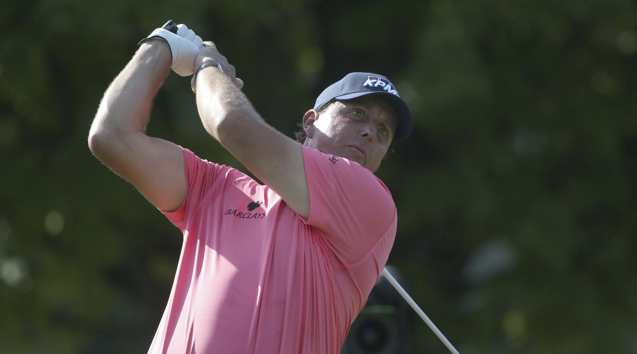 Phil Mickelson watches his tee shot on the 11th hole during the first round of the PGA Championship golf tournament at Baltusrol Golf Club in Springfield, N.J., Thursday, July 28, 2016. (AP Photo/Seth Wenig)