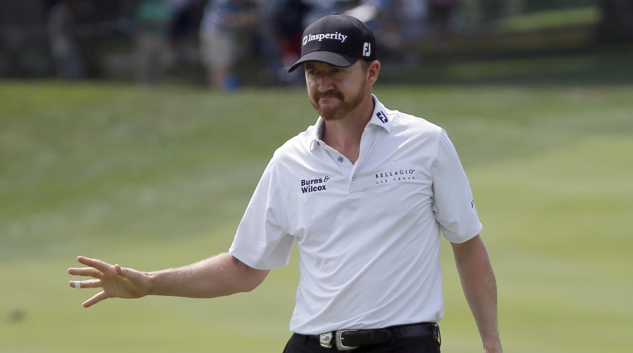 Jimmy Walker reacts to his putt on the third hole during the first round of the PGA Championship golf tournament at Baltusrol Golf Club in Springfield, N.J., Thursday, July 28, 2016. (AP Photo/Tony Gutierrez)