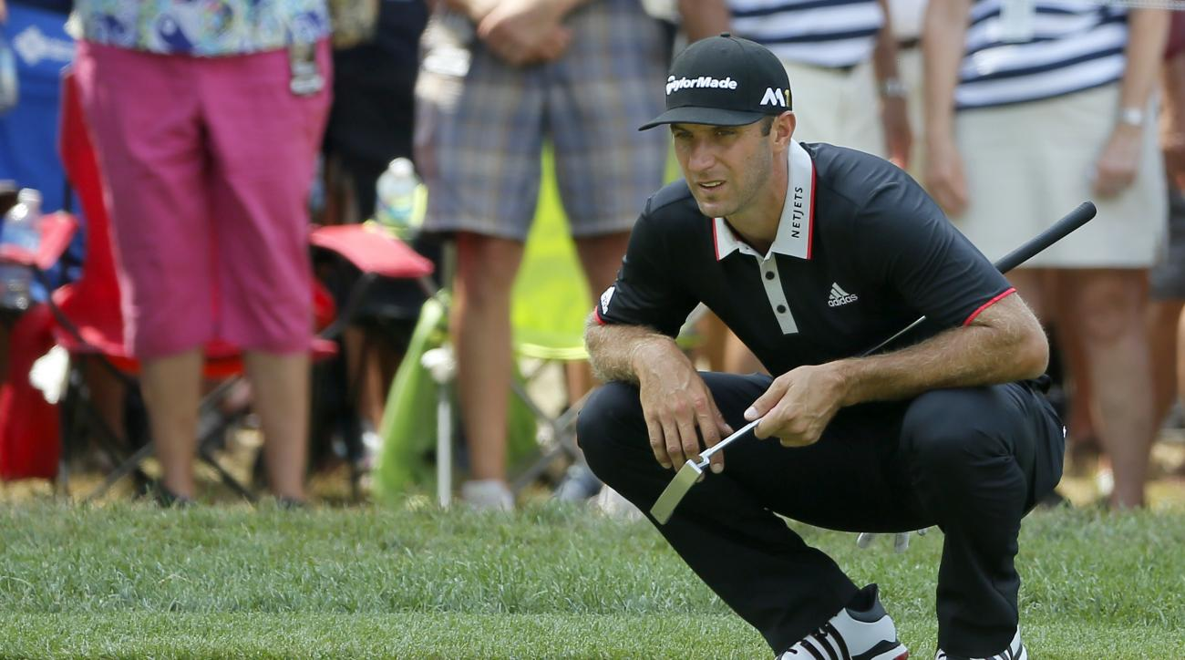 Dustin Johnson lines up a putt on the fourth hole during the first round of the PGA Championship golf tournament at Baltusrol Golf Club in Springfield, N.J., Thursday, July 28, 2016. (AP Photo/Tony Gutierrez)