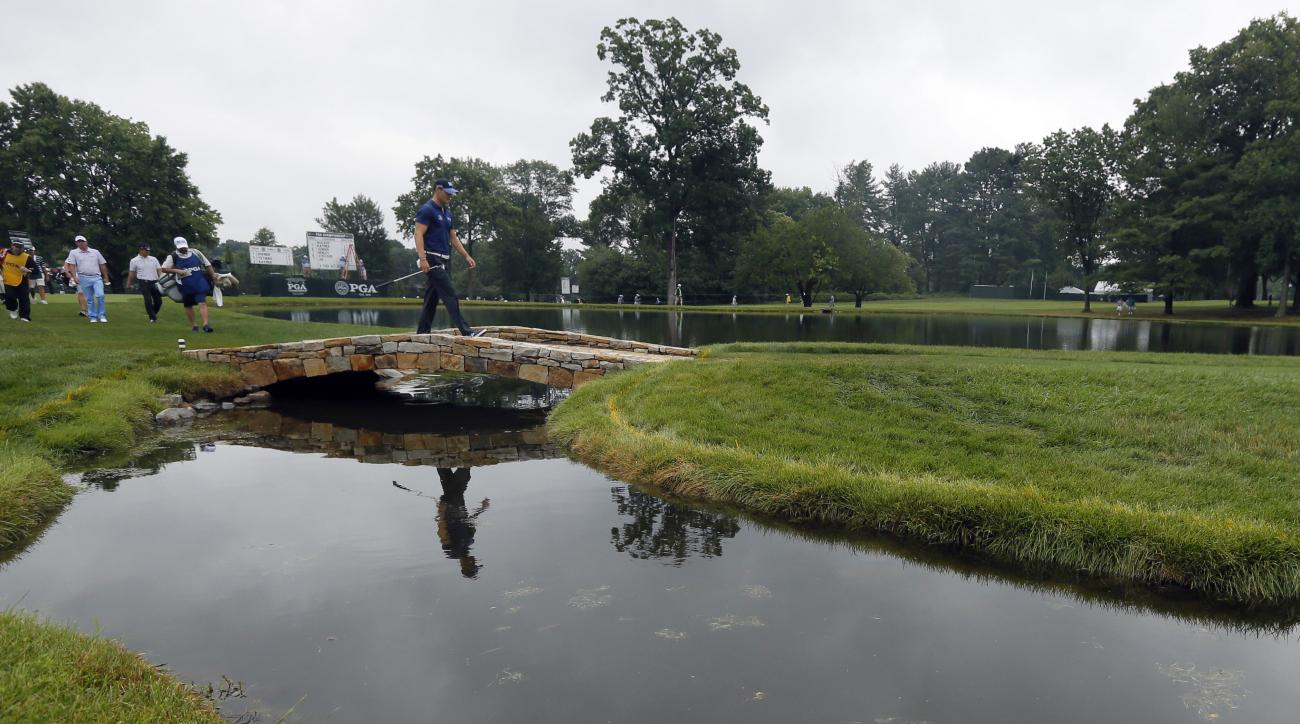 Martin Kaymer walks over a bridge to the fourth green during the second round of the PGA Championship golf tournament at Baltusrol Golf Club in Springfield, N.J., Friday, July 29, 2016. (AP Photo/Tony Gutierrez)