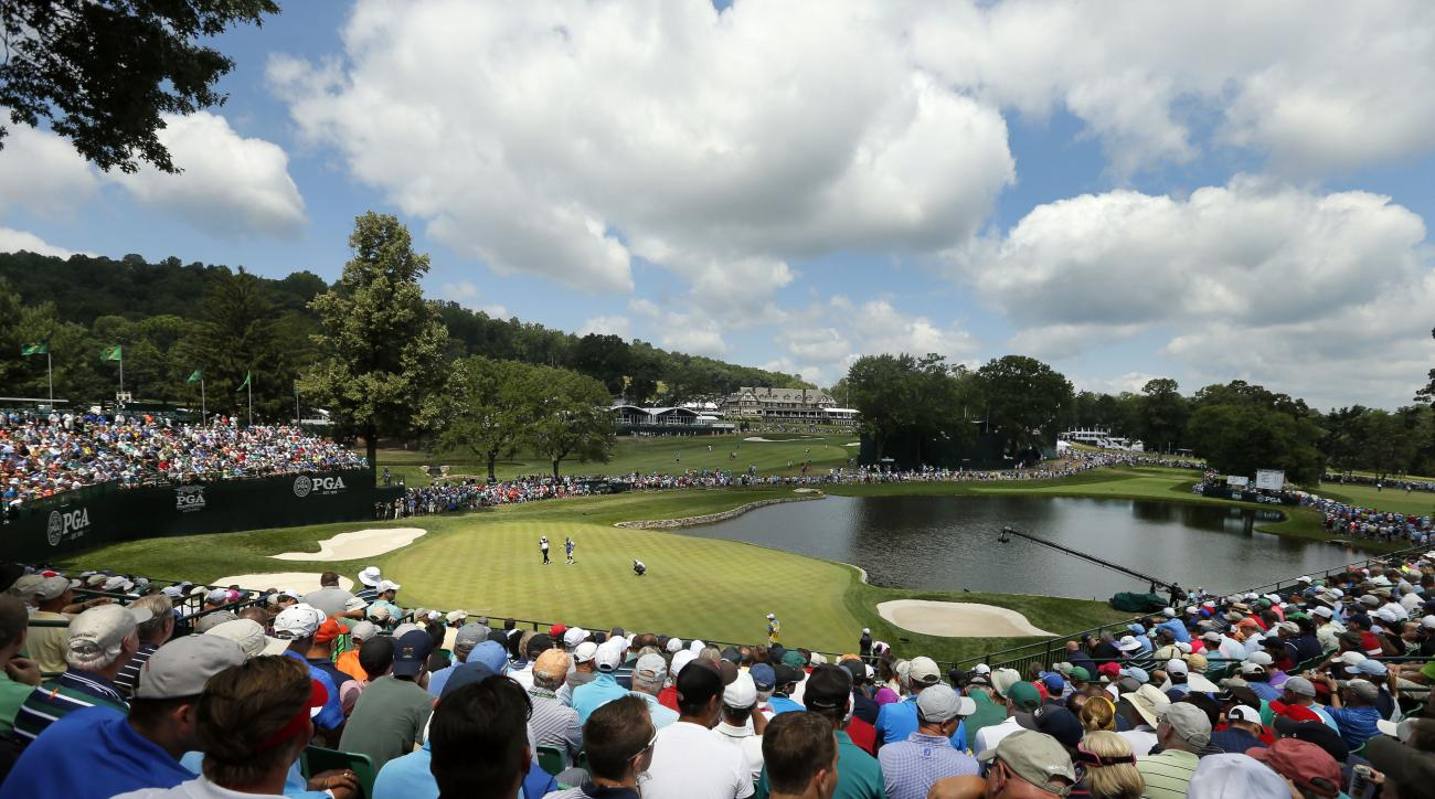 Fans watch as golfers play not he fourth green during the second round of the PGA Championship golf tournament at Baltusrol Golf Club in Springfield, N.J., Friday, July 29, 2016. (AP Photo/Tony Gutierrez)