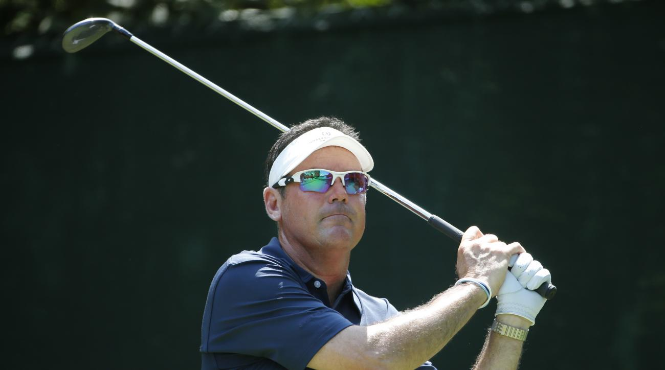 In this photo taken July 28, 2016 Rich Beem watches his tee shot on the 16th hole during the first round of the PGA Championship golf tournament at Baltusrol Golf Club in Springfield, N.J. Beem, the 2002 PGA champion, is a TV analyst for Sky Sports and th