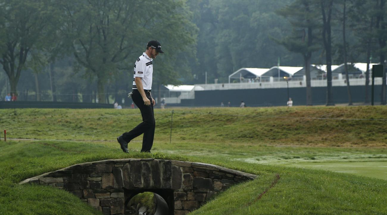 Jimmy Walker walks to the third hole during the third round of the PGA Championship golf tournament at Baltusrol Golf Club in Springfield, N.J., Sunday, July 31, 2016. (AP Photo/Mike Groll)