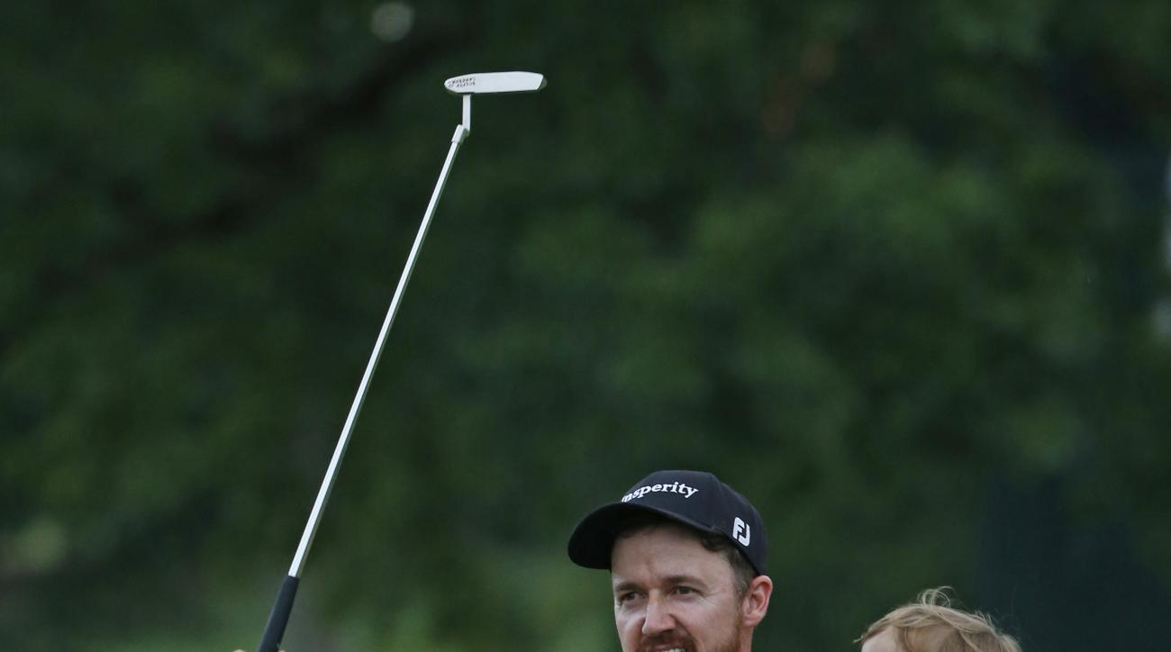 Jimmy Walker celebrates with his son Beckett after winning the PGA Championship golf tournament at Baltusrol Golf Club in Springfield, N.J., Sunday, July 31, 2016. (AP Photo/Mike Groll)
