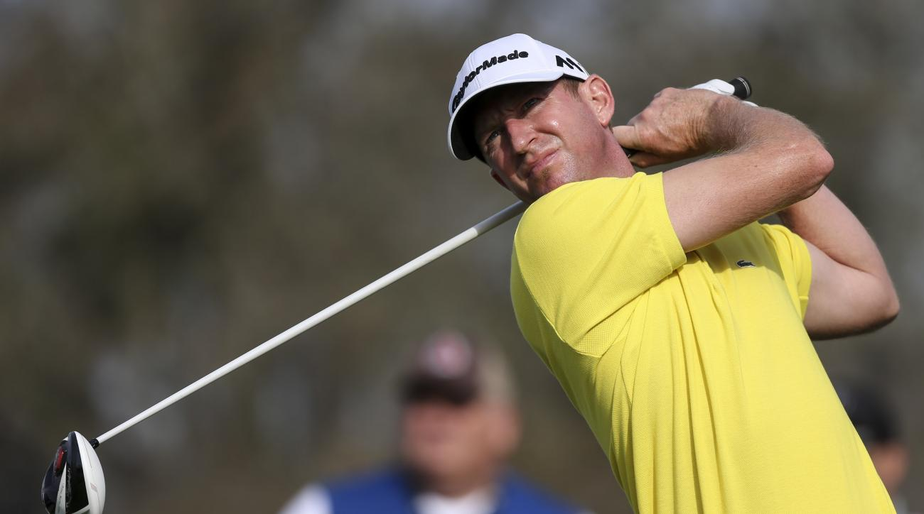 Vaughn Taylor hits the ball on the eighth tee during the second round of the Arnold Palmer Invitational golf tournament in Orlando, Fla., Friday, March 18, 2016. (AP Photo/Willie J. Allen, Jr.)