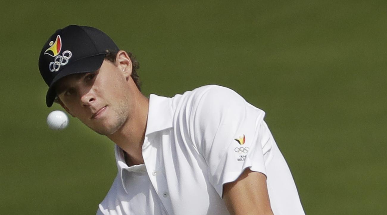 Thomas Pieters of Belgium hits the ball on the 16th green during the first round of the men's golf event at the 2016 Summer Olympics in Rio de Janeiro, Brazil, Thursday, Aug. 11, 2016. (AP Photo/Chris Carlson)