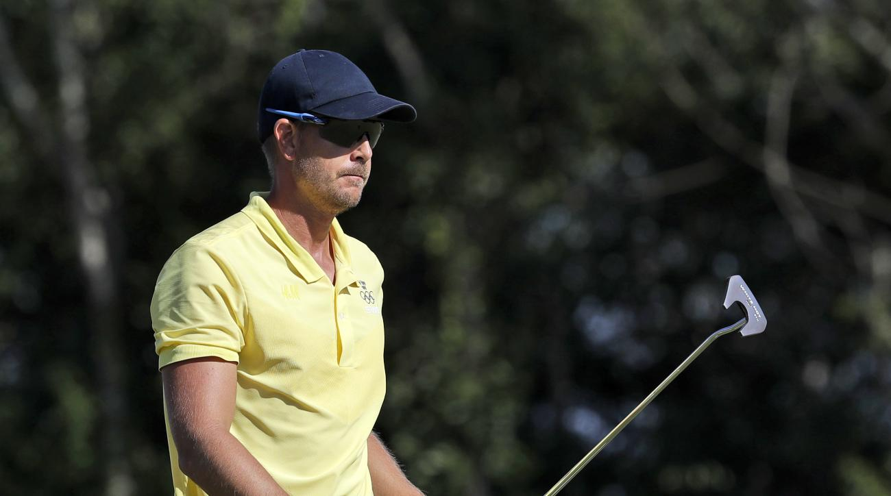 Henrik Stenson of Sweden, walks off on the 13th green during the final round of the men's golf event at the 2016 Summer Olympics in Rio de Janeiro, Brazil, Sunday, Aug. 14, 2016. (AP Photo/Alastair Grant)