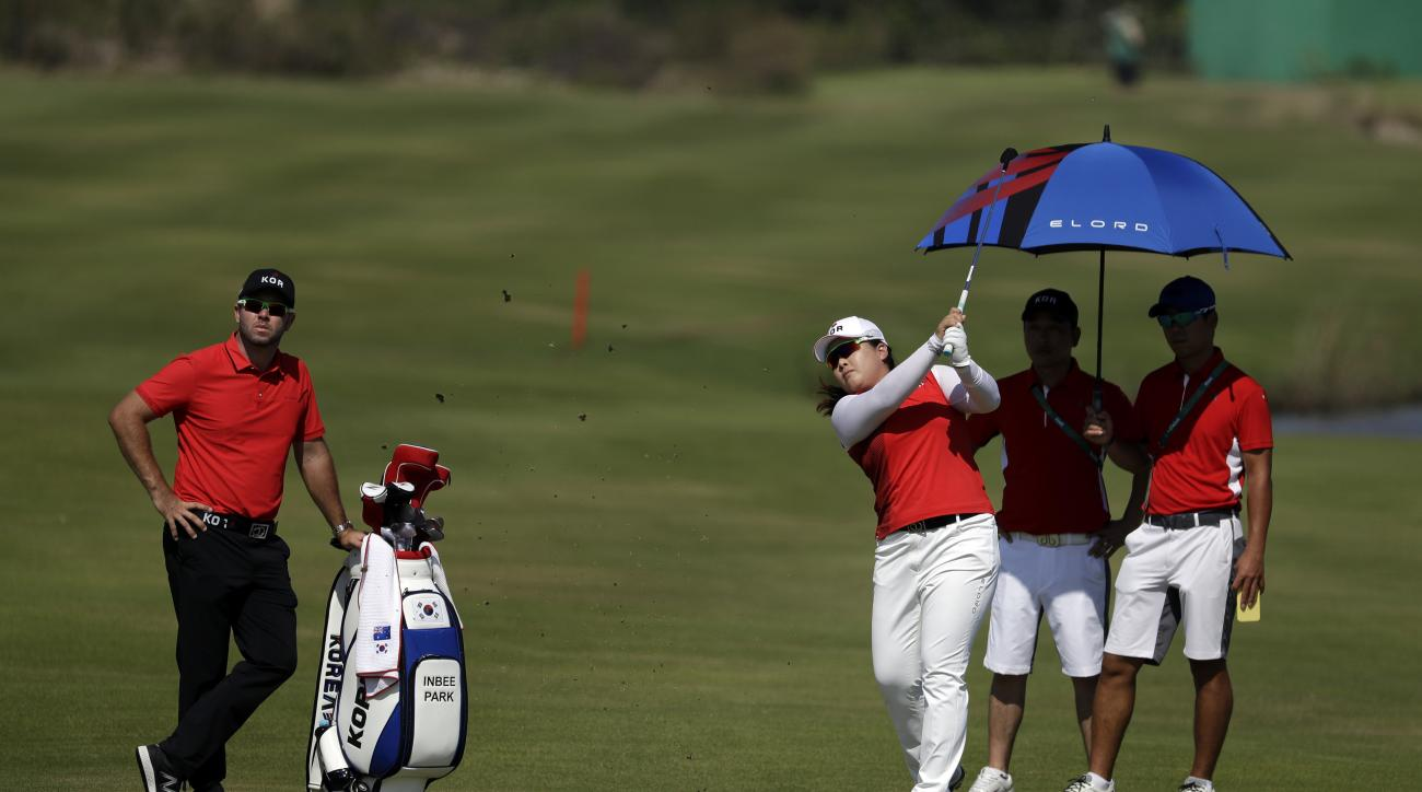Inbee Park of South Korea, hits on to the 5th green during a practice round for the women's golf event at the 2016 Summer Olympics in Rio de Janeiro, Brazil, Monday, Aug. 15, 2016. (AP Photo/Alastair Grant)