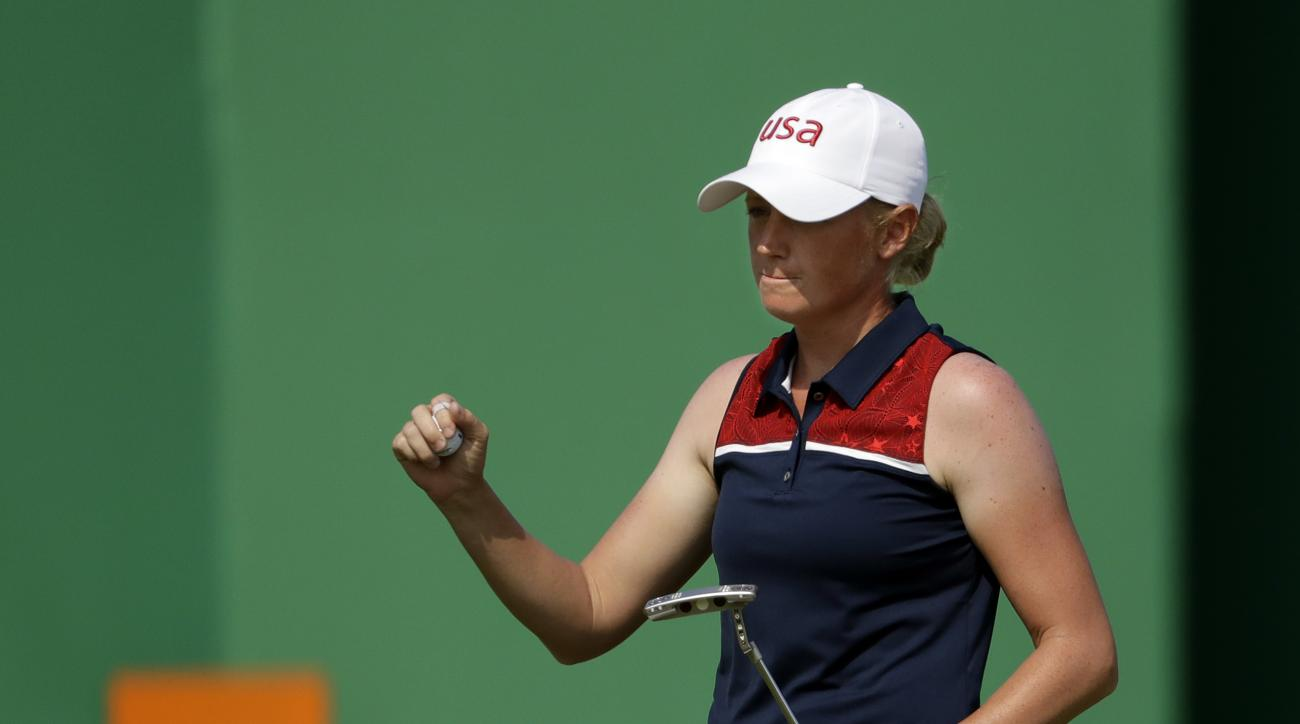 Stacy Lewis of United States, birdies on the 18th hole during the second round of the women's golf event at the 2016 Summer Olympics in Rio de Janeiro, Brazil, Thursday, Aug. 18, 2016. (AP Photo/Chris Carlson)