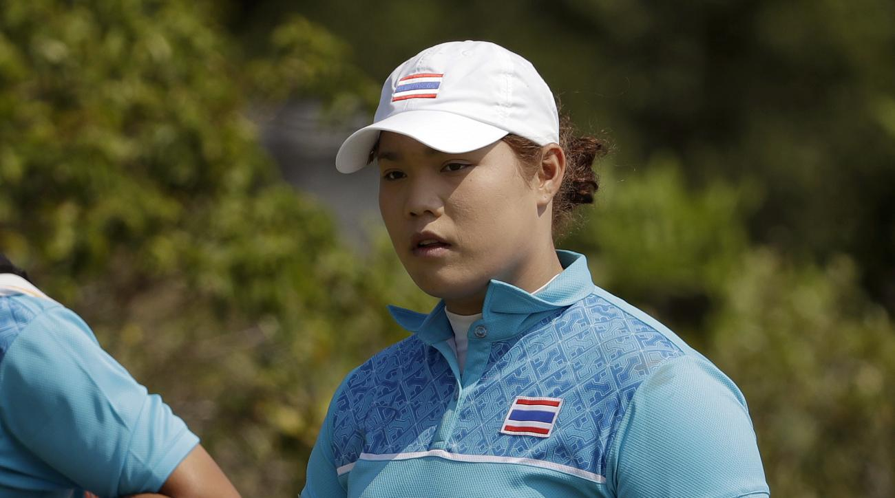Ariya Jutanugarn of Thailand, walks down the 3rd fairway during the third round of the women's golf event at the 2016 Summer Olympics in Rio de Janeiro, Brazil, Friday, Aug. 19, 2016. (AP Photo/Alastair Grant)