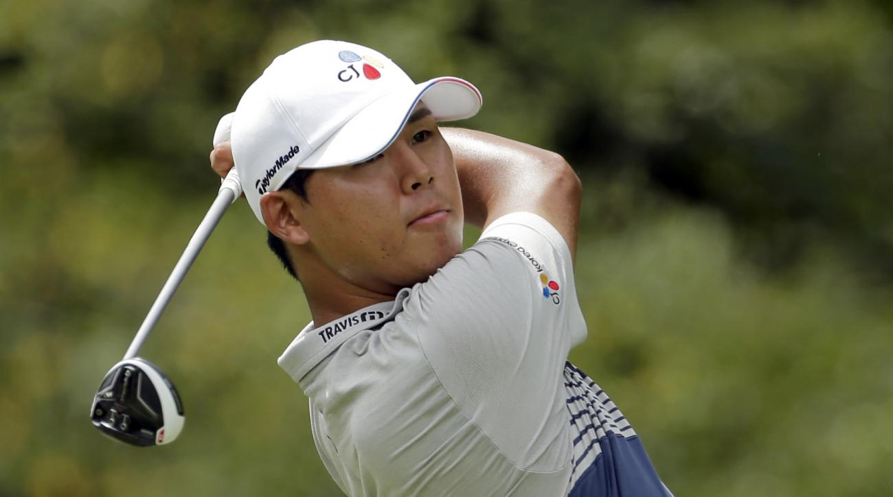 Si Woo Kim watches his tee shot on the eighth hole during the second round of the Wyndham Championship golf tournament in Greensboro, N.C., Friday, Aug. 19, 2016. (AP Photo/Chuck Burton)