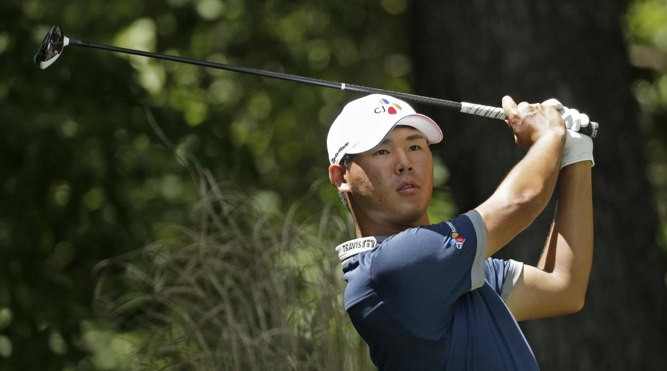 Si Woo Kim watches his tee shot on the second hole during the third round of the Wyndham Championship golf tournament in Greensboro, N.C., Saturday, Aug. 20, 2016. (AP Photo/Chuck Burton)