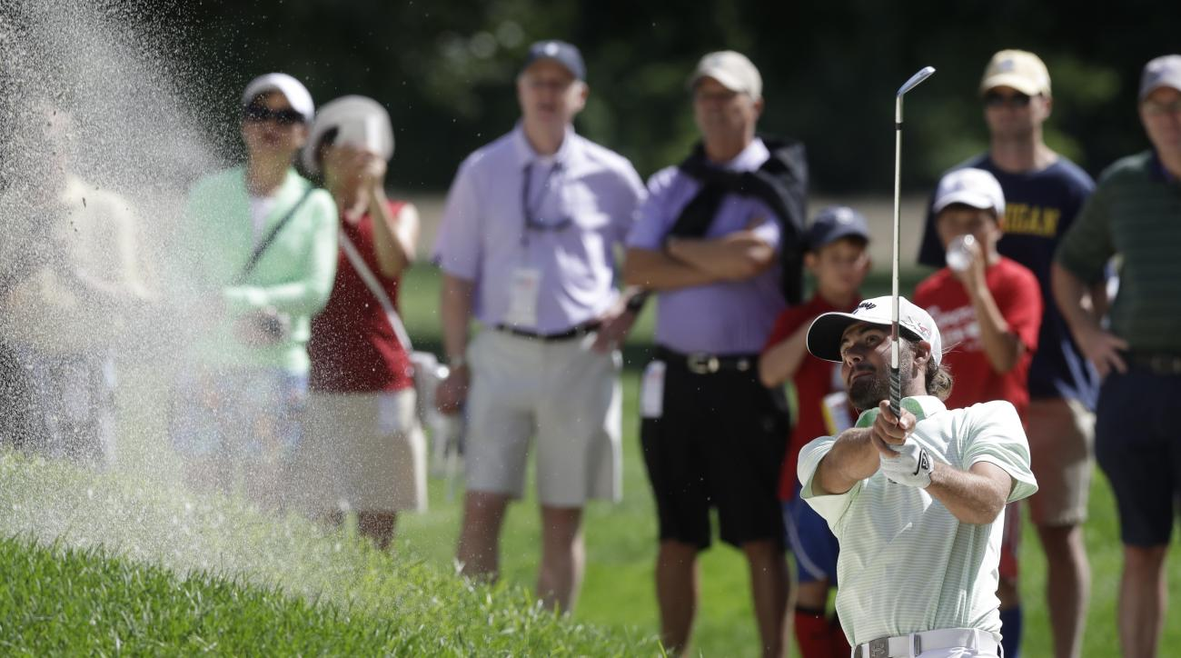 Curtis Luck of Australia hits from a sand trap off the 15th fairway during the final round against Brad Dalke at the U.S. Amateur golf tournament at Oakland Hills Country Club, Sunday, Aug. 21, 2016 in Bloomfield Township, Mich. (AP Photo/Carlos Osorio)