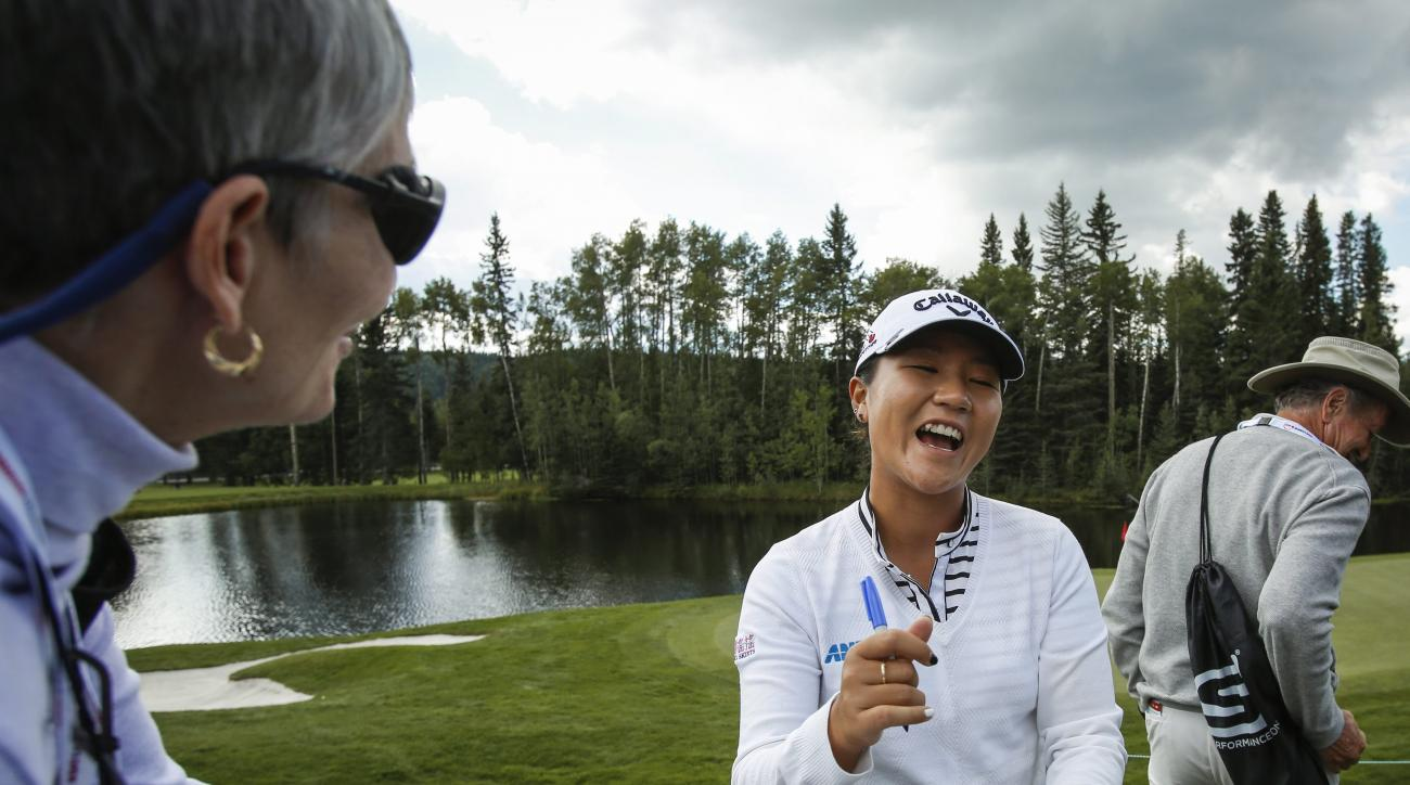 New Zealand's Lydia Ko laughs as she signs autographs during the pro-am at the LPGA Canadian Open golf tournament in Calgary, Alberta, Wednesday, Aug. 24, 2016. (Jeff McIntosh/The Canadian Press via AP)