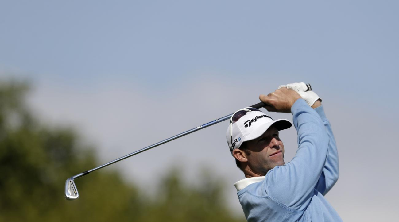 Bradley Dredge from Wales tees off during the golf Czech Masters European Tour Event in Vysoky Ujezd, Czech Republic, Sunday, Aug. 24, 2014. (AP Photo/Petr David Josek)