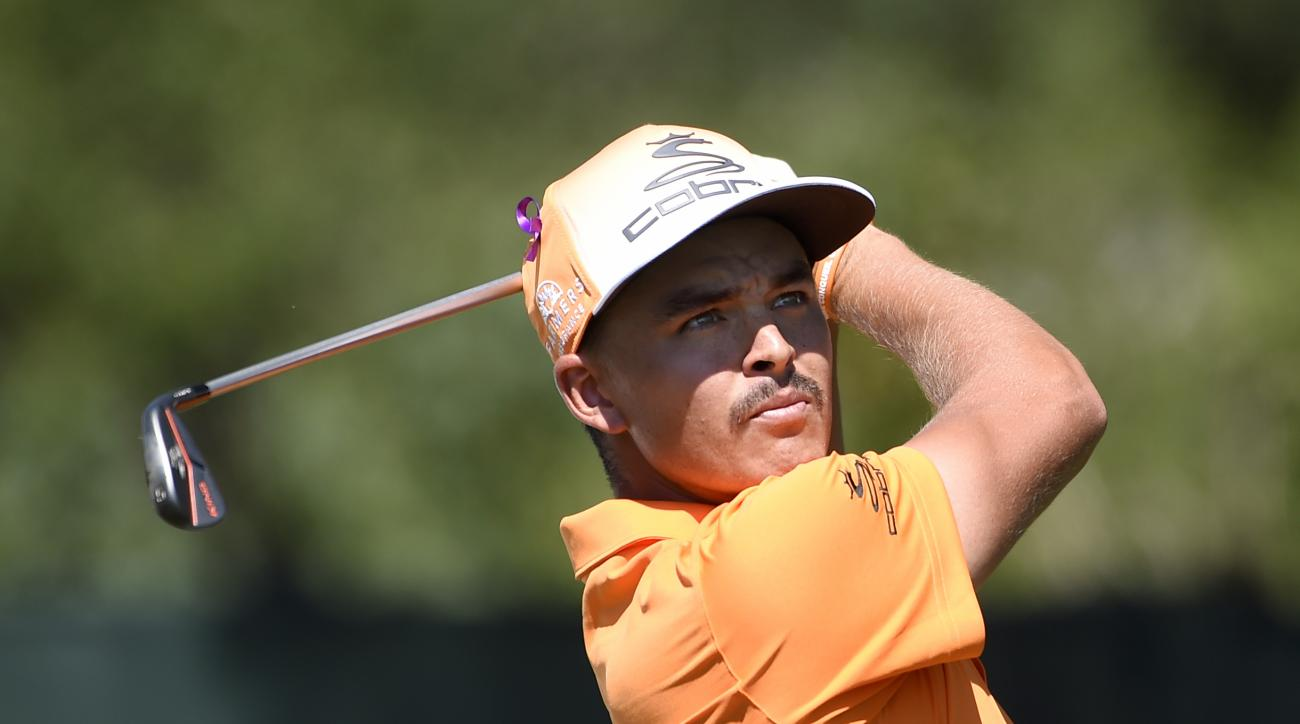 Rickie Fowler tees off from the third hole during the final round of The Barclays golf tournament in Farmingdale, N.Y., Sunday, Aug. 28, 2016. (AP Photo/Kathy Kmonicek)