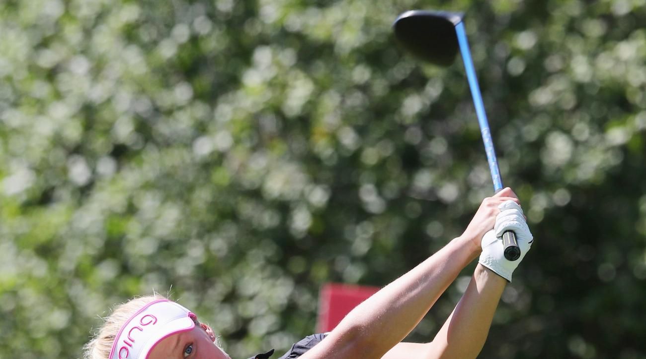 Brooke Henderson, of Canada, hits her tee shot on the 18th hole at the Manulife LPGA Classic golf tournament, in Cambridge, Ontario, on Saturday, Sept. 3, 2016. (Dave Chidley/The Canadian Press via AP)