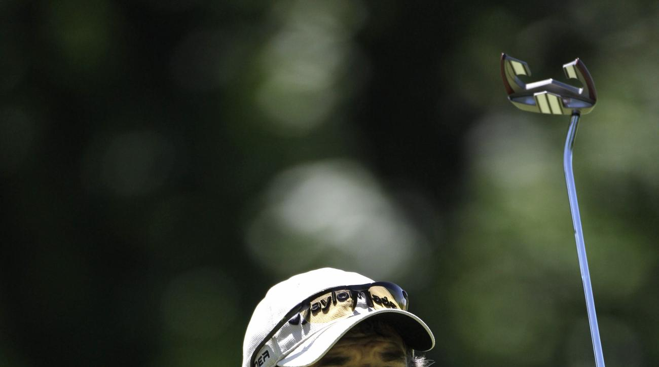 Carlos Franco reacts to his putt on the sixth hole during the first round of the US Bank Championship golf tournament Thursday, July 16, 2009, in Milwaukee. (AP Photo/Morry Gash)