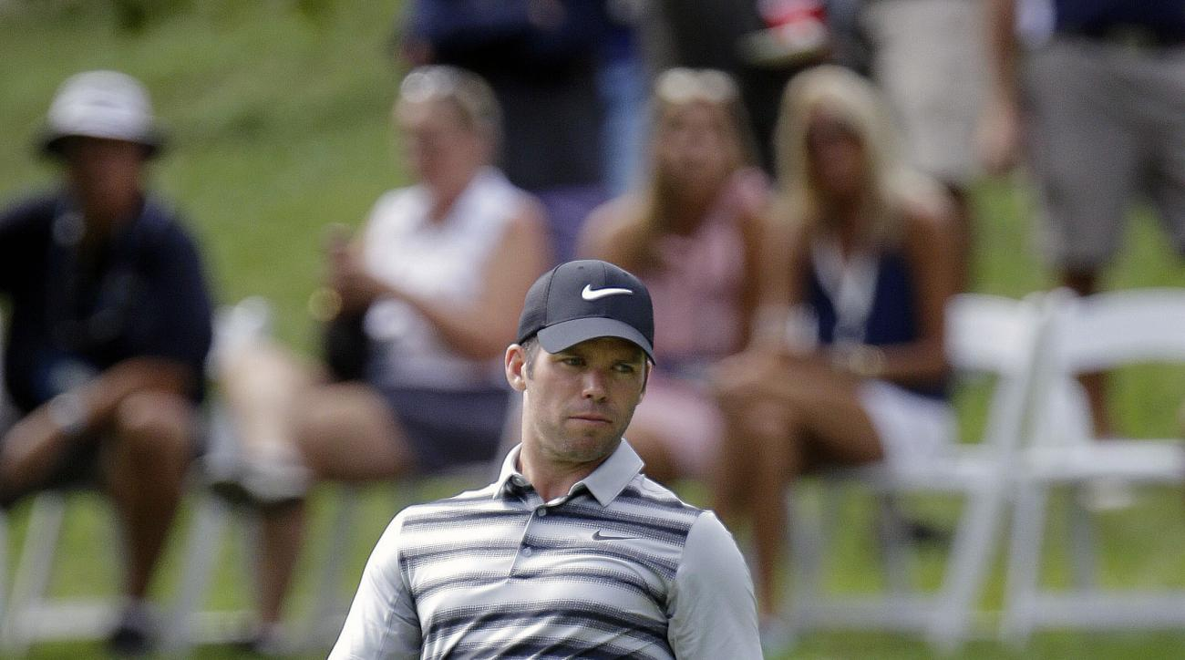 Paul Casey, of England, reacts after missing a putt on the sixth hole during the third round of the BMW Championship golf tournament at Crooked Stick Golf Club in Carmel, Ind., Saturday, Sept. 10, 2016. (AP Photo/AJ Mast)