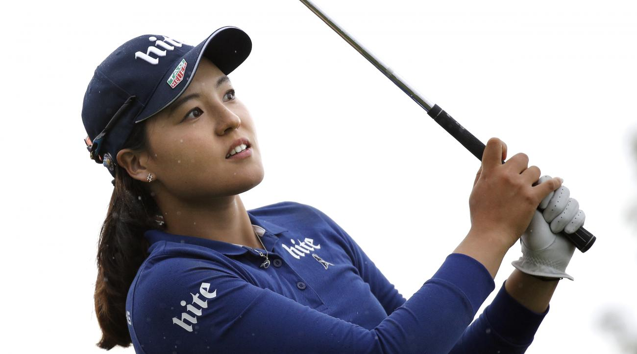 In Gee Chun of South Korea follows the flight of her ball after playing on the 16th hole, during the second round of the Evian Championship women's golf tournament in Evian, eastern France, Friday, Sept. 16, 2016. (AP Photo/Laurent Cipriani)